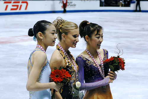 Yu-Na Kim (left), Joannie Rochette (middle), and Fumie Suguri (right) all had impressive short program performances. Photo by Darren Barefoot.